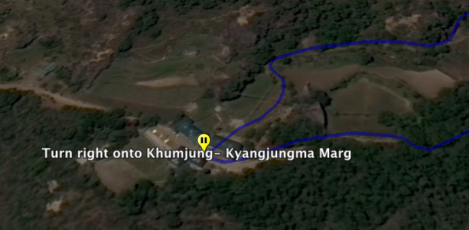Turn right onto Khumjung - Kyangjugma Marg. and continue on for 1.0 km. (.62 mi.).