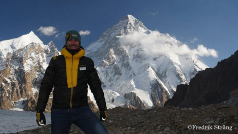fredrik strang at broad peak base camp with k2 in the back